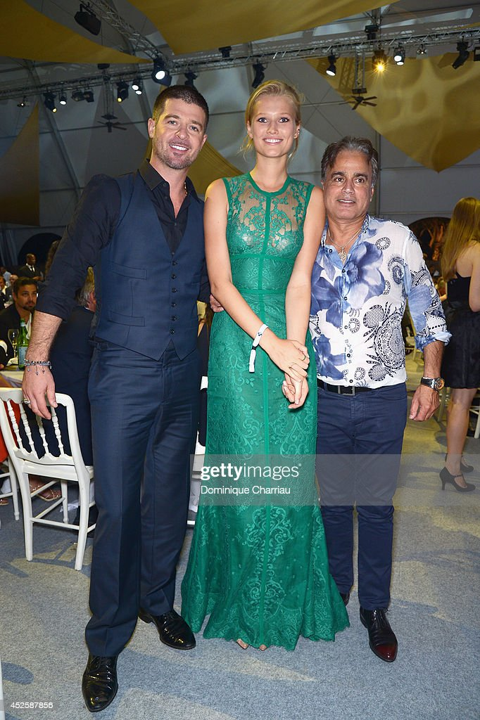 <a gi-track='captionPersonalityLinkClicked' href=/galleries/search?phrase=Robin+Thicke&family=editorial&specificpeople=724390 ng-click='$event.stopPropagation()'>Robin Thicke</a>, <a gi-track='captionPersonalityLinkClicked' href=/galleries/search?phrase=Toni+Garrn&family=editorial&specificpeople=4425236 ng-click='$event.stopPropagation()'>Toni Garrn</a> and a guest attend the Leonardo Dicaprio Foundation Launch at Domaine Bertaud Belieu on July 23, 2014 in Saint-Tropez, France.