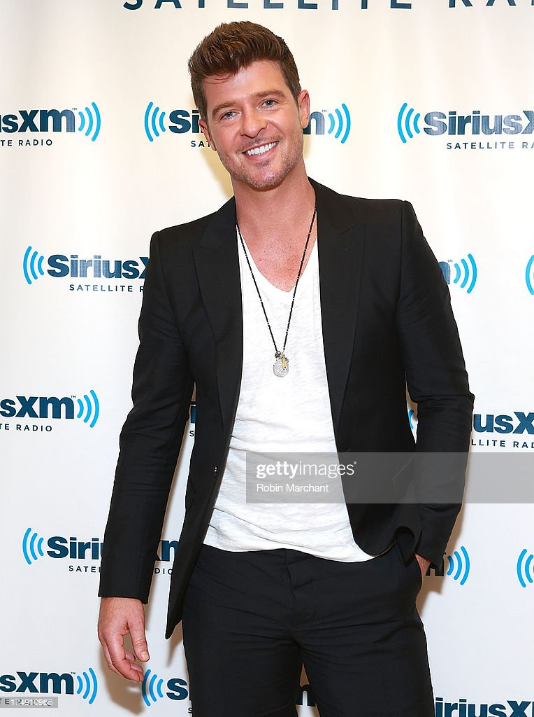 <a gi-track='captionPersonalityLinkClicked' href=/galleries/search?phrase=Robin+Thicke&family=editorial&specificpeople=724390 ng-click='$event.stopPropagation()'>Robin Thicke</a> visits at SiriusXM Studios on July 29, 2013 in New York City.