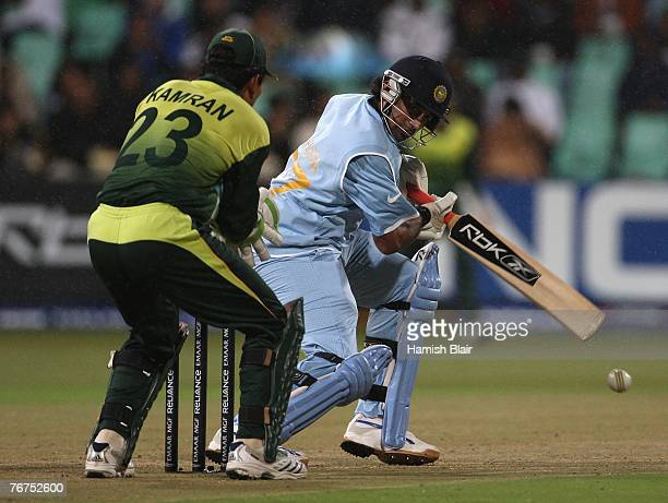 Robin Uthappa of India runs the ball to third man with Kamran Akmal of Pakistan looking on during the ICC Twenty20 Cricket World Championship match...