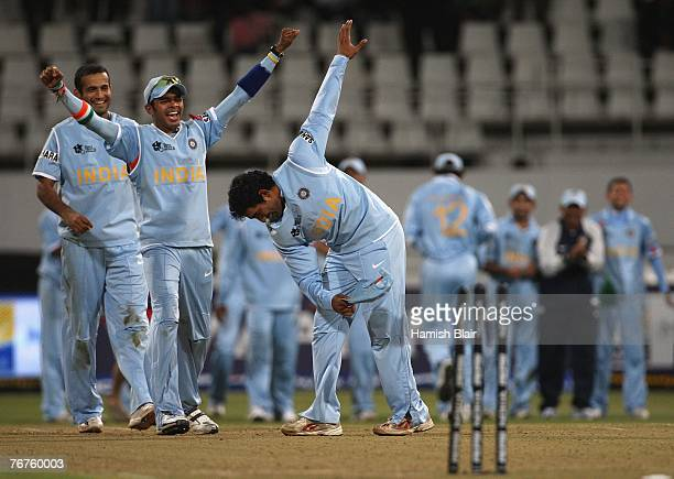 Robin Uthappa of India takes a bow after hitting the stumps in a bowl off eventually won by India after the match was tied at the end of both teams...