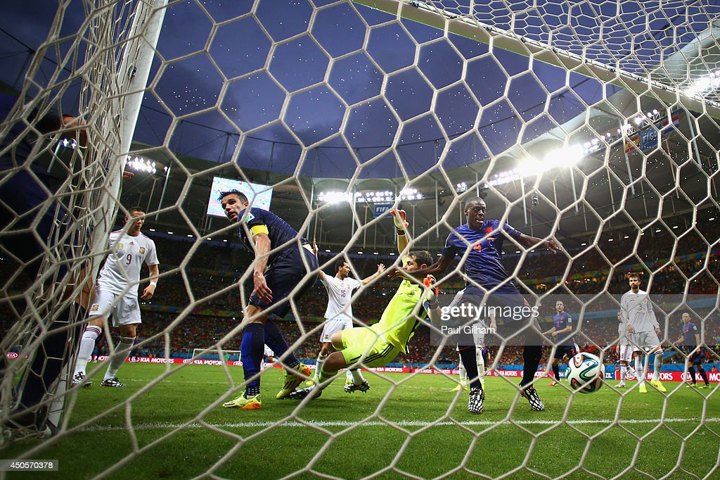 Robin van Persie and <a gi-track='captionPersonalityLinkClicked' href=/galleries/search?phrase=Bruno+Martins+Indi&family=editorial&specificpeople=7155940 ng-click='$event.stopPropagation()'>Bruno Martins Indi</a> of the Netherlands watch as teammate Stefan de Vrij of the Netherlands (L) scores the team's third goal against <a gi-track='captionPersonalityLinkClicked' href=/galleries/search?phrase=Iker+Casillas&family=editorial&specificpeople=215446 ng-click='$event.stopPropagation()'>Iker Casillas</a> of Spain during the 2014 FIFA World Cup Brazil Group B match between Spain and Netherlands at Arena Fonte Nova on June 13, 2014 in Salvador, Brazil.