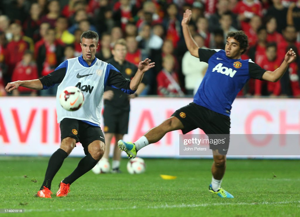 Robin van Persie and Fabio da Silva of Manchester United in action during a first team training session as part of their pre-season tour of Bangkok, Australia, China, Japan and Hong Kong on July 19, 2013 in Sydney, Australia.