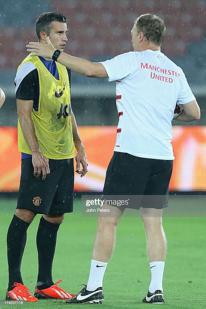 Robin van Persie and Manager <a gi-track='captionPersonalityLinkClicked' href=/galleries/search?phrase=David+Moyes&family=editorial&specificpeople=215482 ng-click='$event.stopPropagation()'>David Moyes</a> of Manchester United in action during a first team training session as part of their pre-season tour of Bangkok, Australia, China, Japan and Hong Kong on July 22, 2013 in Yokohama, Japan.