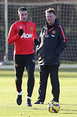 Robin van Persie and Manager Louis van Gaal of Manchester United in action during a first team training session at Aon Training Complex on December 5...