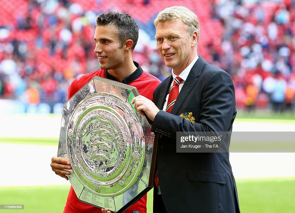 Robin van Persie and Manager of Manchester United <a gi-track='captionPersonalityLinkClicked' href=/galleries/search?phrase=David+Moyes&family=editorial&specificpeople=215482 ng-click='$event.stopPropagation()'>David Moyes</a> pose with the shield during the FA Community Shield match between Manchester United and Wigan Athletic at Wembley Stadium on August 11, 2013 in London, England.