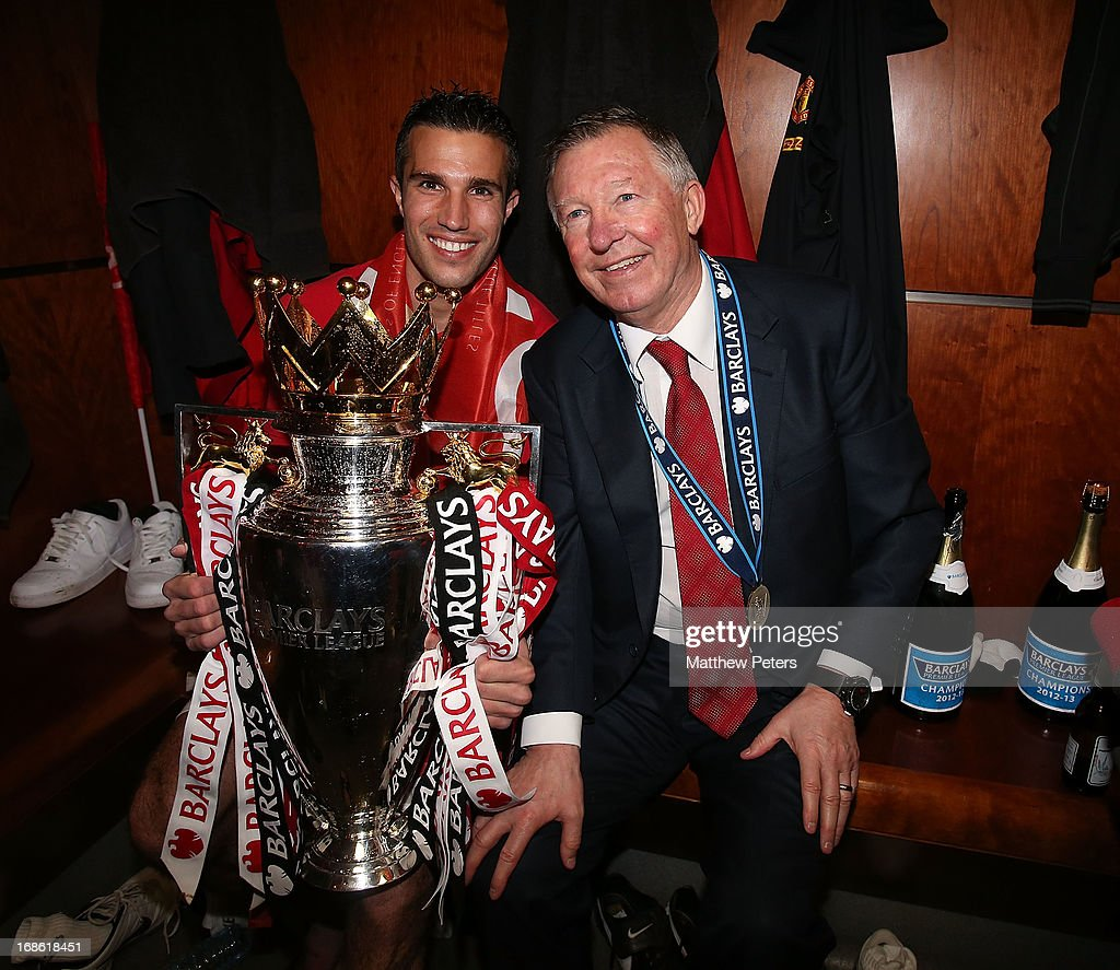 Robin van Persie and Manager Sir <a gi-track='captionPersonalityLinkClicked' href=/galleries/search?phrase=Alex+Ferguson&family=editorial&specificpeople=203067 ng-click='$event.stopPropagation()'>Alex Ferguson</a> of Manchester United celebrate with the Barclays Premier League trophy in the dressing room after the Barclays Premier League match between Manchester United and Swansea City at Old Trafford on May 12, 2013 in Manchester, England.