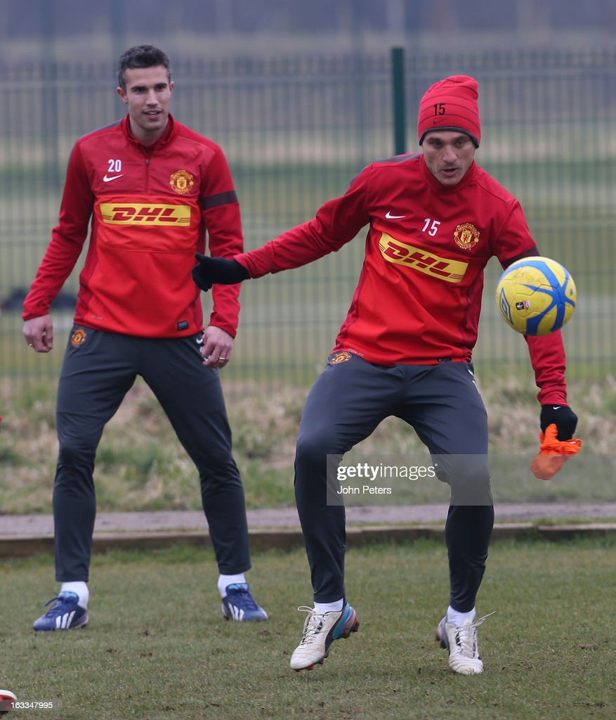 Robin van Persie and Nemanja Vidic of Manchester United in action during a first team training session at Carrington Training Ground on March 8, 2013 in Manchester, England.
