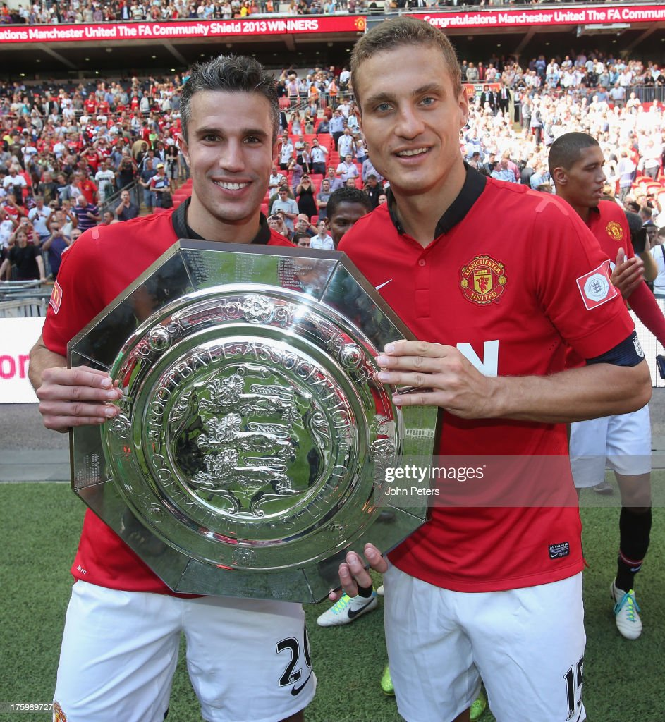 Robin van Persie and <a gi-track='captionPersonalityLinkClicked' href=/galleries/search?phrase=Nemanja+Vidic&family=editorial&specificpeople=497253 ng-click='$event.stopPropagation()'>Nemanja Vidic</a> of Manchester United pose with the FA Community Shield trophy after the FA Community Shield match between Manchester United and Wigan Athletic at Wembley Stadium on August 11, 2013 in London, England.