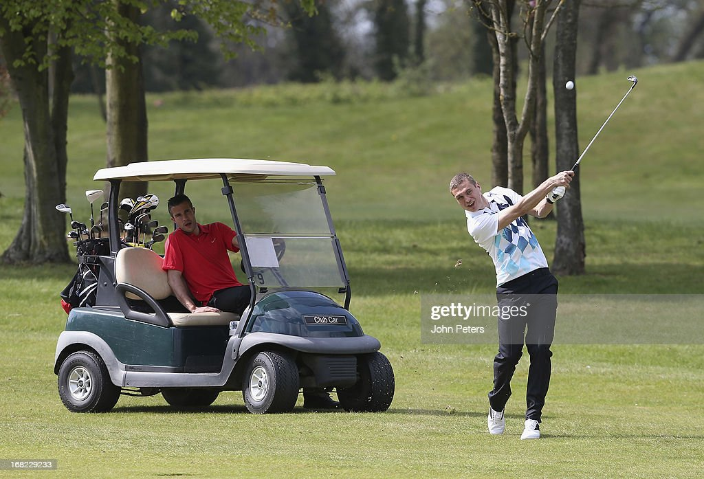 Robin van Persie and Nemanja Vidic of Manchester United take part in a Players v Coaching Staff golf match at Dunham Massey Golf Club on May 7, 2013 in Manchester, England.