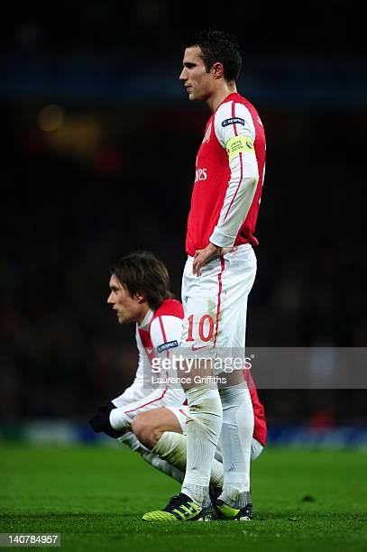 Robin van Persie and Tomas Rosicky of Arsenal look dejected during the UEFA Champions League Round of 16 second leg match between Arsenal and AC...