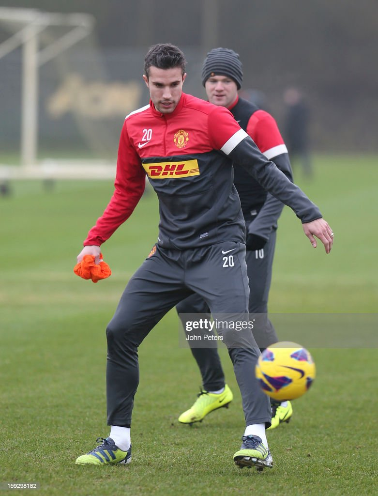Robin van Persie (L) and <a gi-track='captionPersonalityLinkClicked' href=/galleries/search?phrase=Wayne+Rooney&family=editorial&specificpeople=157598 ng-click='$event.stopPropagation()'>Wayne Rooney</a> of Manchester United in action during a first team training session at Carrington Training Ground on January 11, 2013 in Manchester, England.
