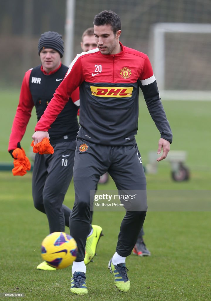 Robin van Persie (R) and <a gi-track='captionPersonalityLinkClicked' href=/galleries/search?phrase=Wayne+Rooney&family=editorial&specificpeople=157598 ng-click='$event.stopPropagation()'>Wayne Rooney</a> of Manchester United in action during a first team training session at Carrington Training Ground on January 11, 2013 in Manchester, England.