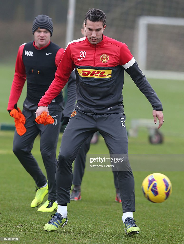 Robin van Persie (R) and Wayne Rooney of Manchester United in action during a first team training session at Carrington Training Ground on January 11, 2013 in Manchester, England.