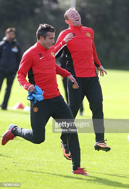 Robin van Persie and Wayne Rooney of Manchester United in action during a first team training session ahead of their UEFA Champions League match...