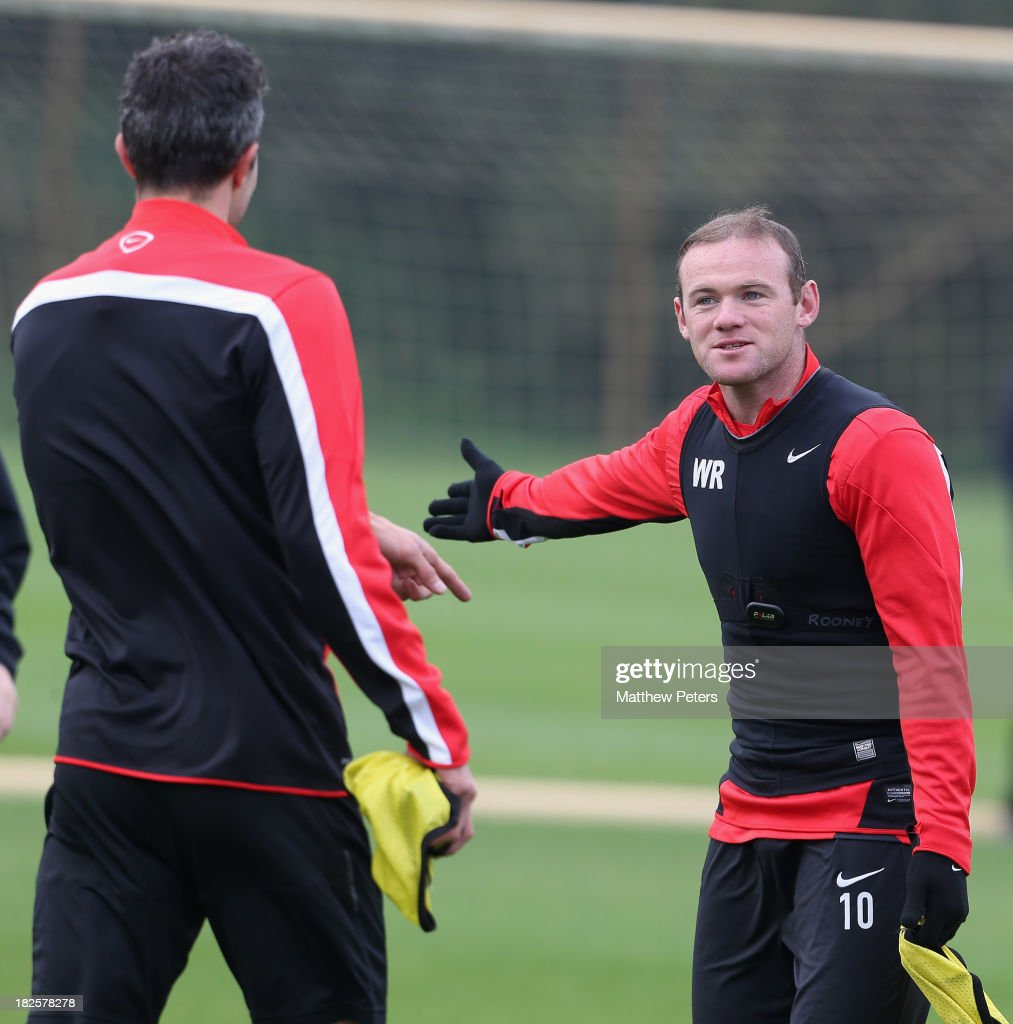 Robin van Persie and Wayne Rooney of Manchester United in action during a first team training session, ahead of their UEFA Champions League match against Shaktar Donetsk, at Aon Training Complex on October 1, 2013 in Manchester, England.