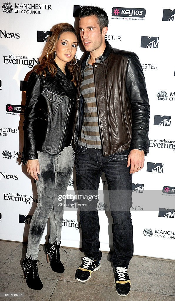 Robin van Persie and wife Bouchra Elbali arrive to watch Alicia Keys performing as part of MTV Crashes... at Manchester Cathedral on September 24, 2012 in Manchester, England.