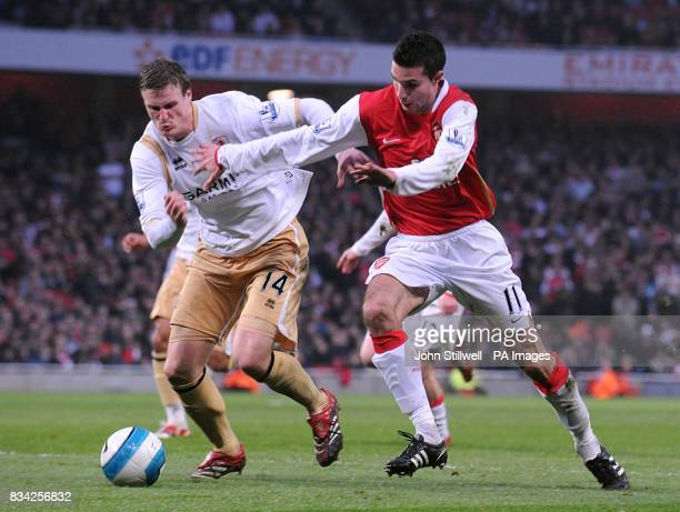 Robin Van Persie Arsenal and Robert Huth Middlesbrough battle for the ball