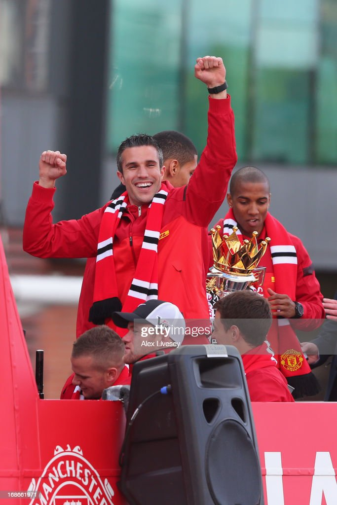 Robin Van Persie celebrates onboard the open topped bus outside Old Trafford as <a gi-track='captionPersonalityLinkClicked' href=/galleries/search?phrase=Wayne+Rooney&family=editorial&specificpeople=157598 ng-click='$event.stopPropagation()'>Wayne Rooney</a> looks on during the Manchester United Premier League winners parade on May 13, 2013 in Manchester, England.