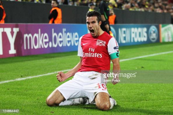 Robin van Persie of Arsenal celebrates after scoring his team's first goal during the UEFA Champions League Group F match between Borussia Dortmund...