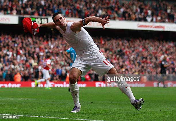 Robin van Persie of Arsenal celebrates as he scores their second goal during the Barclays Premier League match between Arsenal and Sunderland at the...