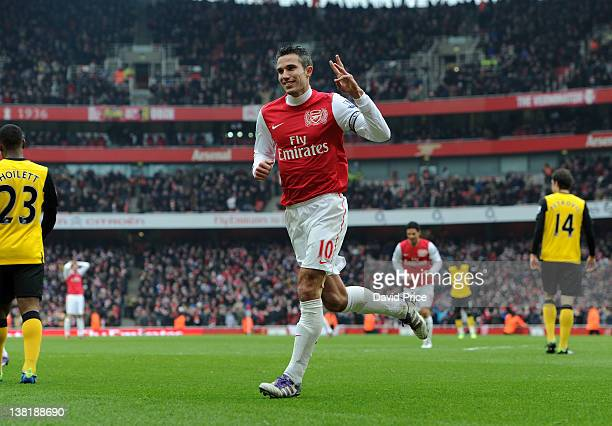 Robin van Persie of Arsenal celebrates completing a hatrick after scoring Arsenal's 6th goal during the Barclays Premier League match between Arsenal...