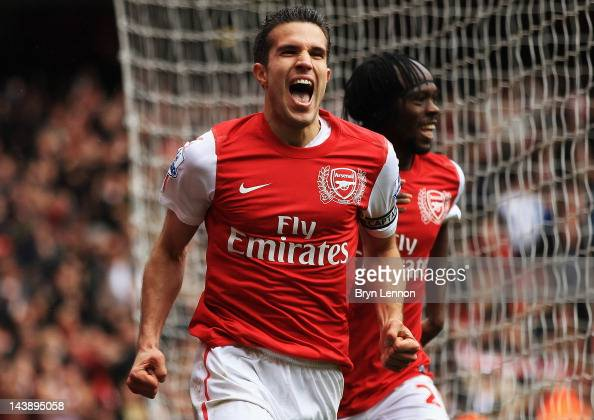 Robin van Persie of Arsenal celebrates scoring their third goal during the Barclays Premier League match between Arsenal and Norwich City at the...