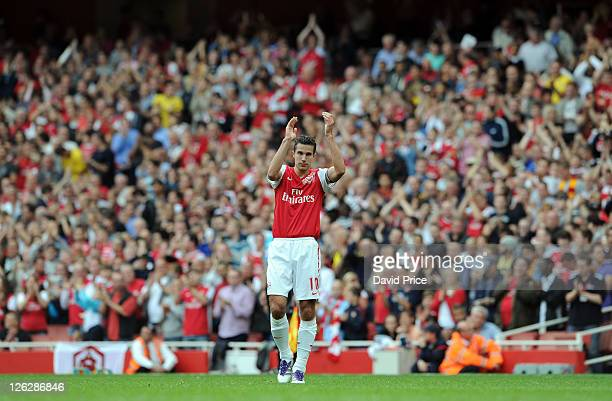 Robin van Persie of Arsenal claps the fans after being subsituted during the Barclays Premier League match between Arsenal and Bolton Wanderers at...