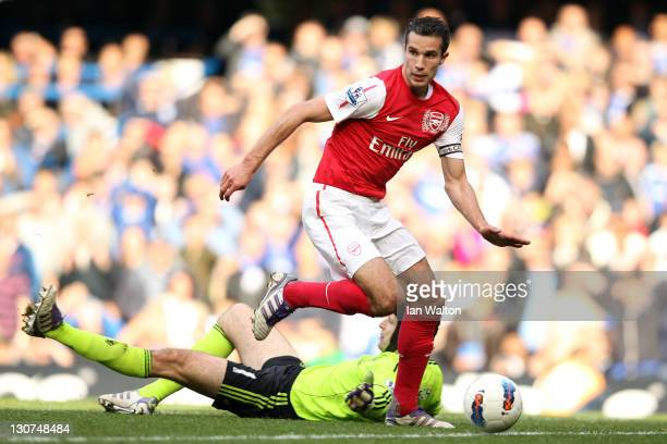 Robin van Persie of Arsenal goes past goalkeeper Petr Cech to score Arsenal's fourth goal during the Barclays Premier League match between Chelsea...
