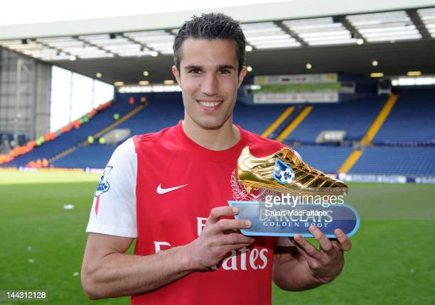 Robin van Persie of Arsenal poses with the golden boot after the Barclays Premier League match between West Bromwich Albion and Arsenal at The...