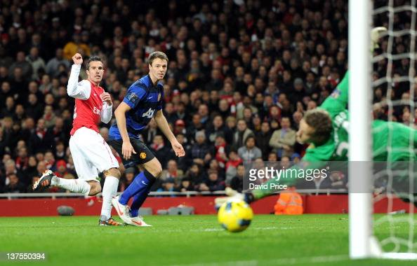 Robin van Persie of Arsenal scores past goalkeeper Anders Lindegaard of Manchester Utd as Jonny Evans Man Utd looks on during the Barclays Premier...