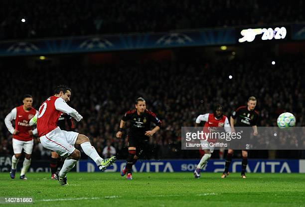 Robin van Persie of Arsenal scores their third goal from the penalty spot during the UEFA Champions League Round of 16 second leg match between...