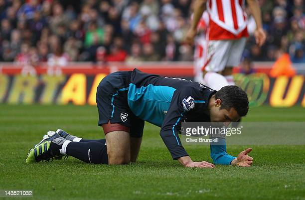 Robin Van Persie of Arsenal shows his dejection after a near miss during the Barclays Premier League match between Stoke City and Arsenal at...