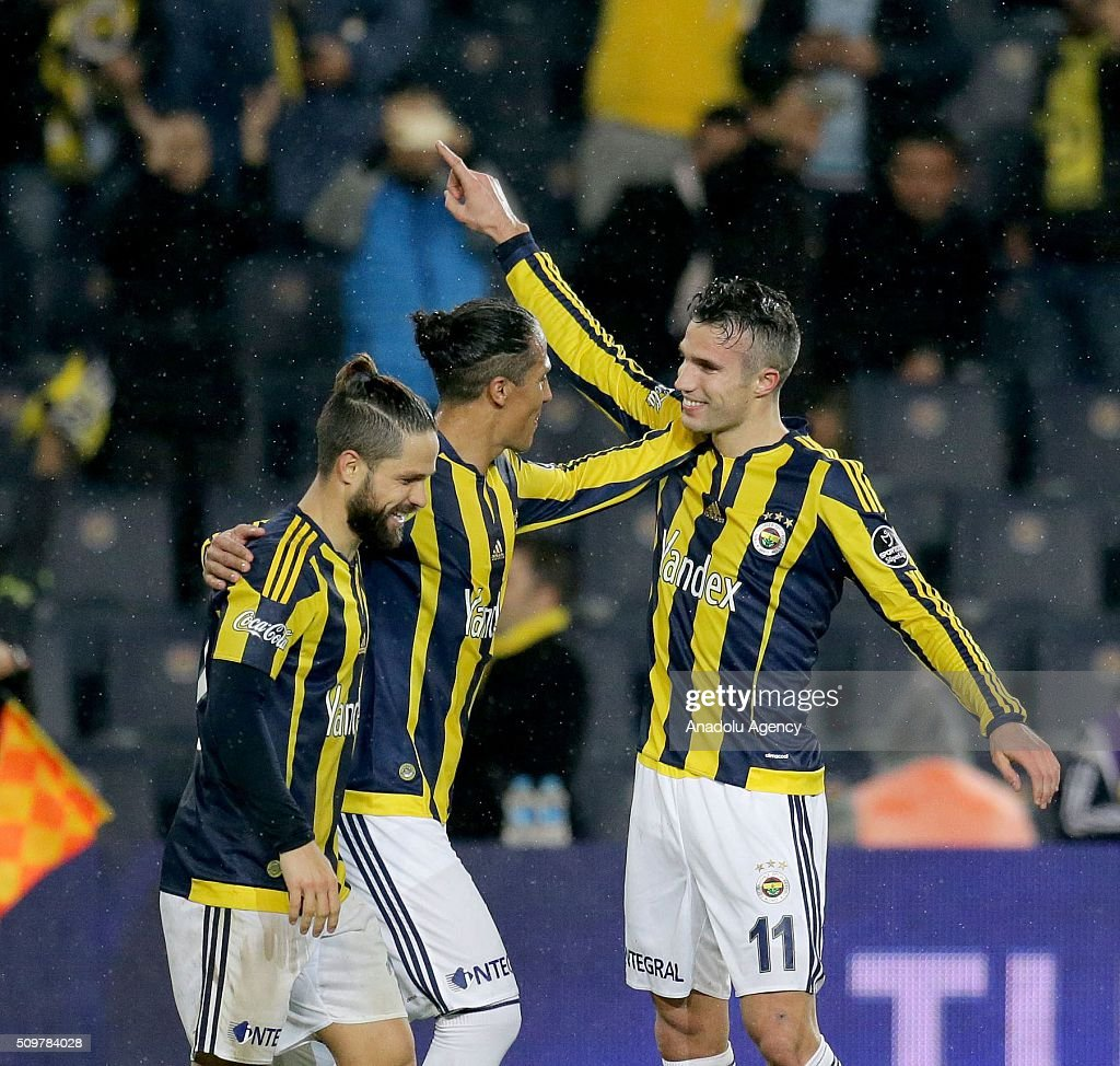 Robin Van Persie (R) of Fenerbahce celebrates after scoring a goal during Turkish Spor Toto Super Lig football match between Fenerbahce and Kasimpasa at Fenerbahce Sukru Saracoglu Sports Complex in Istanbul, Turkey on February 12, 2016