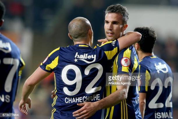 Robin Van Persie of Fenerbahce celebrates with his teammate after scoring a goal during the Ziraat Turkish Cup semi final soccer match between...