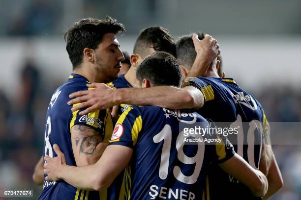Robin Van Persie of Fenerbahce celebrates with his teammates after scoring a goal during the Ziraat Turkish Cup semi final soccer match between...