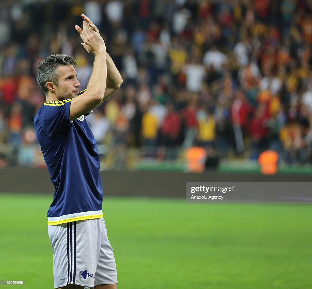 Robin Van Persie of Fenerbahce greets the supporters after the Turkish Spor Toto Super League football match between Kayserispor and Fenerbahce at...