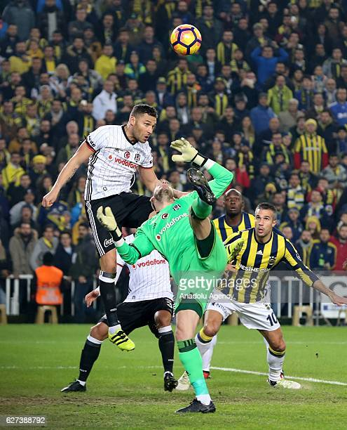 Robin van Persie of Fenerbahce in action against Dusko Tosiç and Fabri of Besiktas during the Turkish Spor Toto Super Lig match between Fenerbahce...