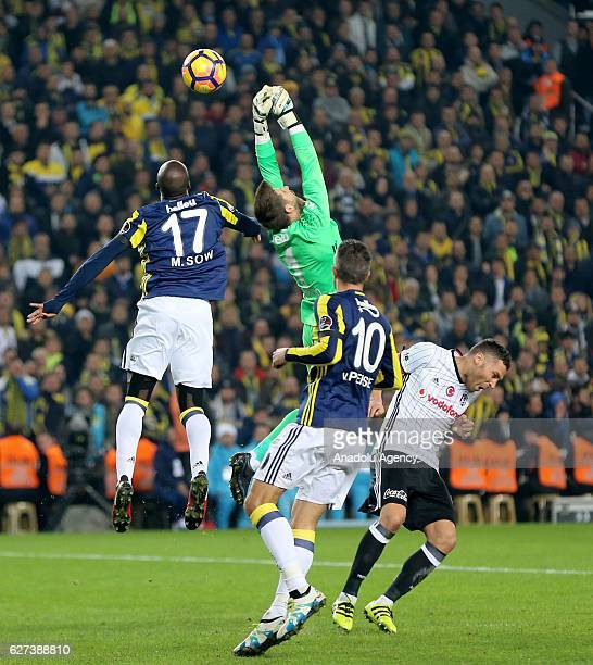 Robin van Persie of Fenerbahce in action against Fabri of Besiktas during the Turkish Spor Toto Super Lig match between Fenerbahce and Besiktas at...