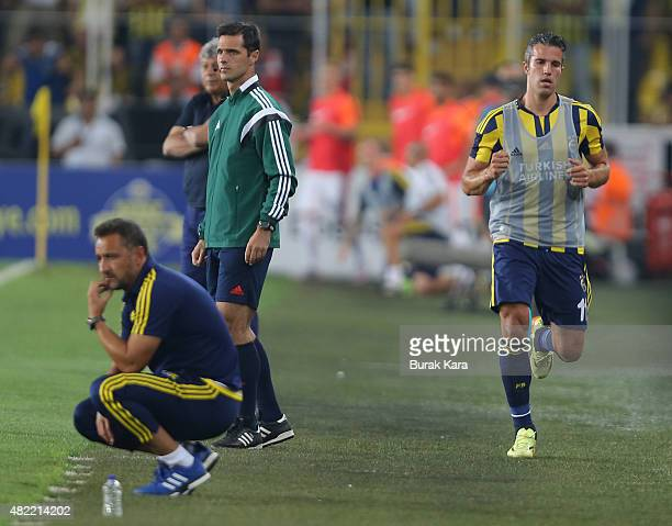 Robin van Persie of Fenerbahce runs near the pitch as Fenerbahce's coach Vítor Pereira watches the match during UEFA Champions League Third...