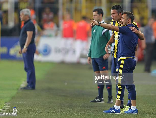 Robin van Persie of Fenerbahce talks with his coach Vítor Pereira during UEFA Champions League Third Qualifying Round 1st Leg match betweeen...