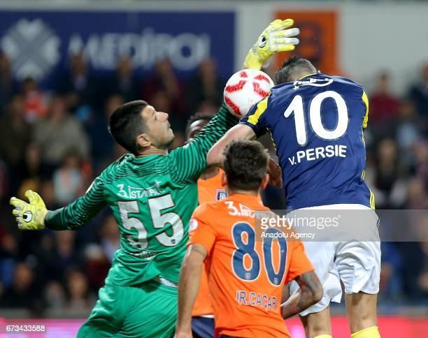 Robin Van Persie of Fenerbahce vies for the ball against Faruk Cakir of Medipol Basaksehir during the Ziraat Turkish Cup semi final soccer match...