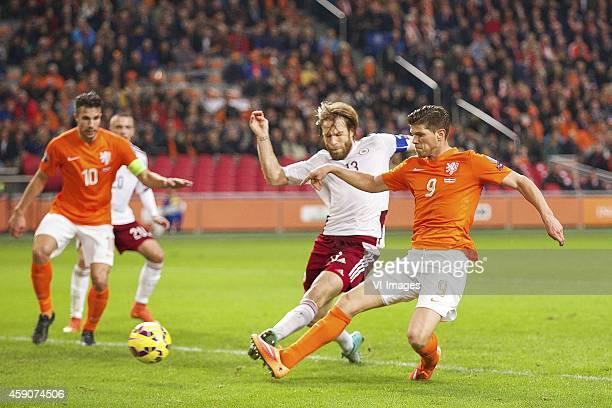 Robin van Persie of Holland Antons Kurakins of Latvia Joel Veltman of Holland KlaasJan Huntelaar of Holland 30 during the match between Netherlands...
