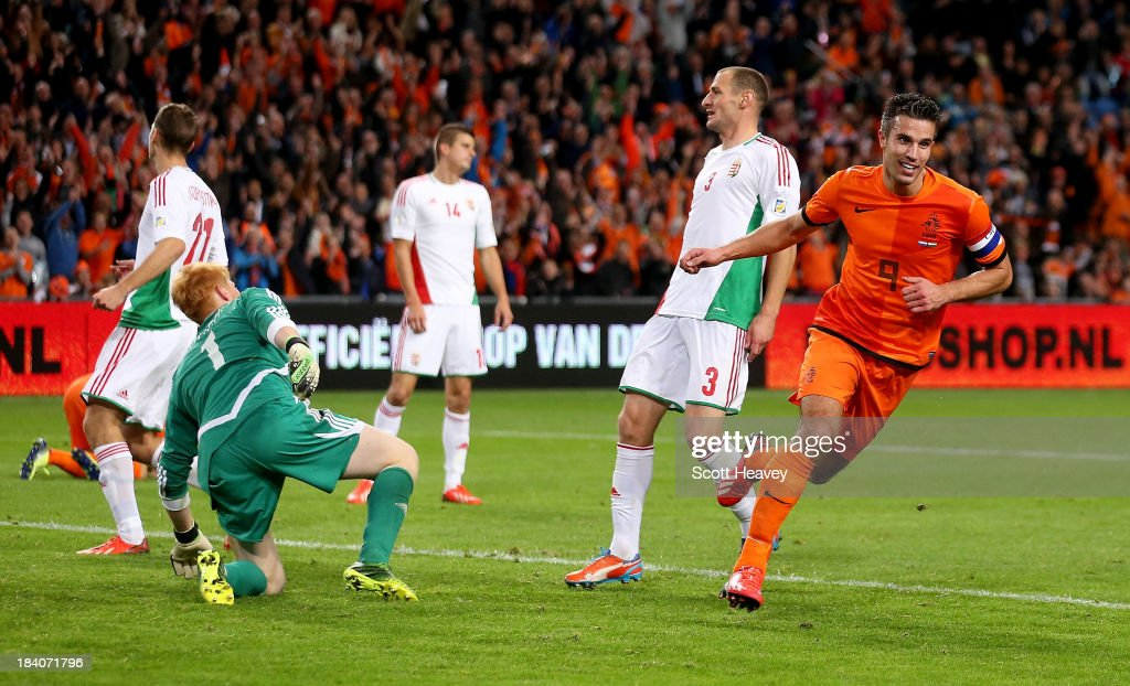 Robin van Persie of Holland celebrates after scoring their fifth goal during the FIFA 2014 World Cup Qualifing match between Holland and Hungary at Amsterdam Arena on October 11, 2013 in Amsterdam, Netherlands.