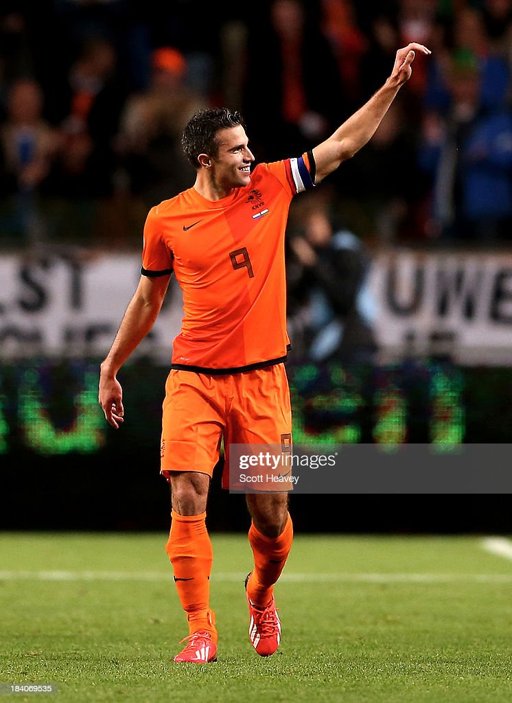 Robin van Persie of Holland celebrates after scoring their first goal during the FIFA 2014 World Cup Qualifing match between Holland and Hungary at Amsterdam Arena on October 11, 2013 in Amsterdam, Netherlands.