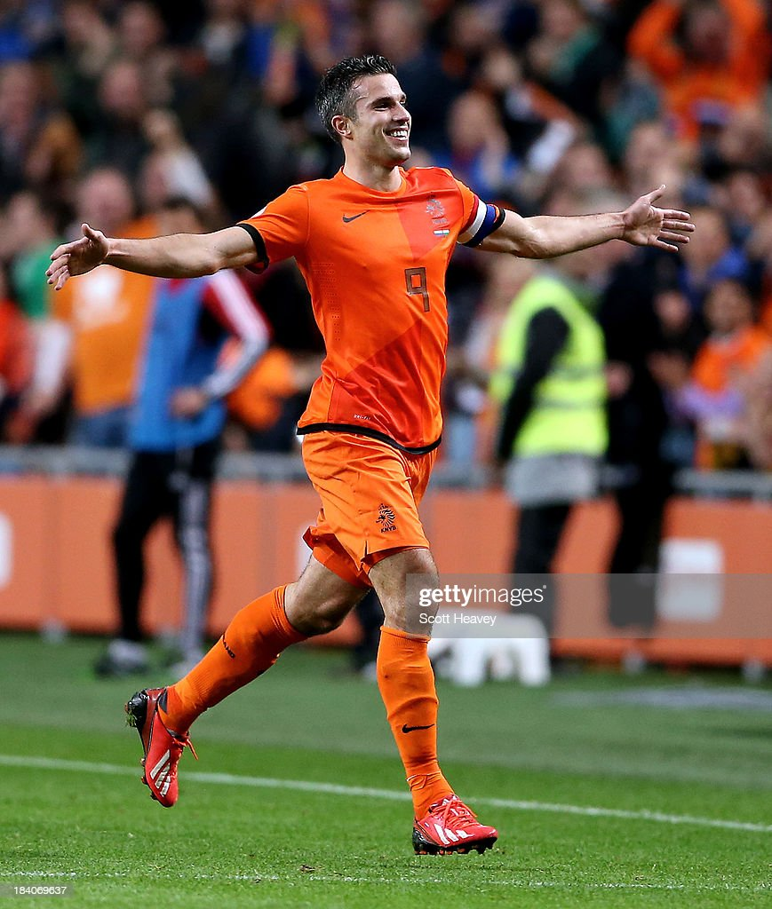 Robin van Persie of Holland celebrates after scoring their fourth goal during the FIFA 2014 World Cup Qualifing match between Holland and Hungary at Amsterdam Arena on October 11, 2013 in Amsterdam, Netherlands.