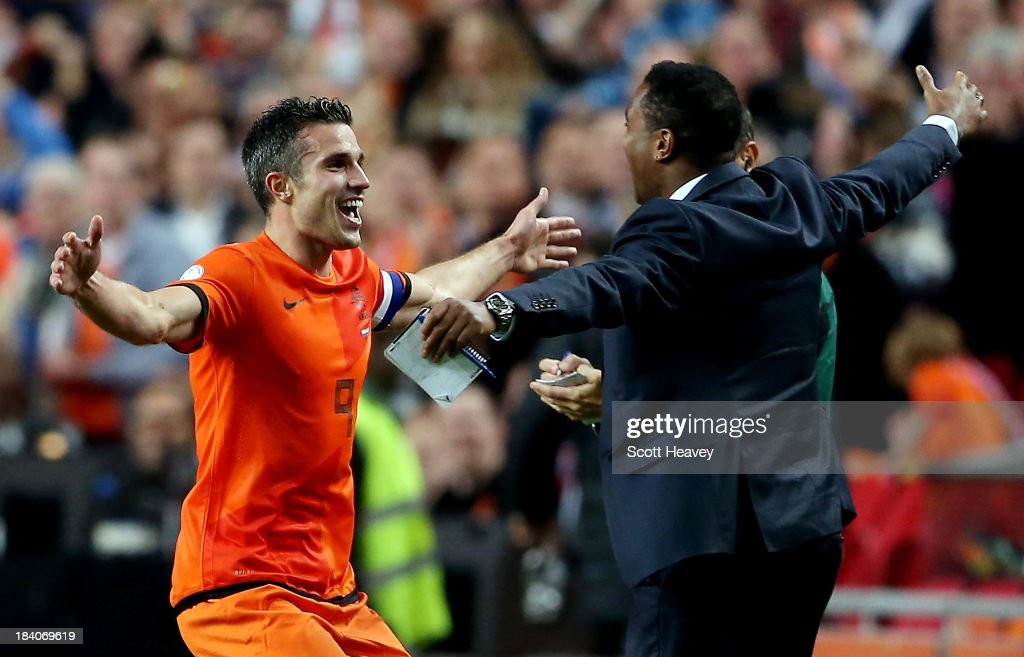 Robin van Persie of Holland celebrates with <a gi-track='captionPersonalityLinkClicked' href=/galleries/search?phrase=Patrick+Kluivert&family=editorial&specificpeople=167278 ng-click='$event.stopPropagation()'>Patrick Kluivert</a> after scoring their fourth goal during the FIFA 2014 World Cup Qualifing match between Holland and Hungary at Amsterdam Arena on October 11, 2013 in Amsterdam, Netherlands.