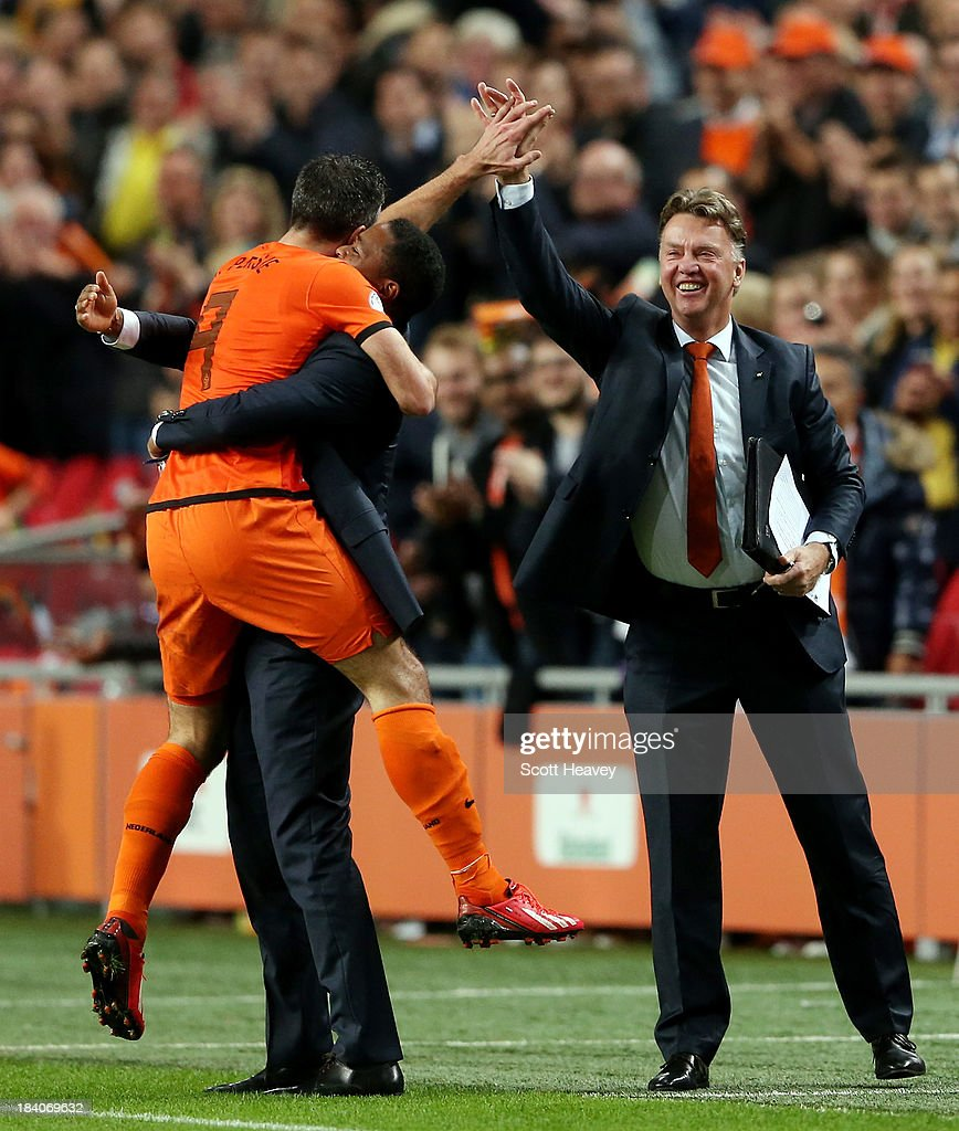 Robin van Persie of Holland celebrates with <a gi-track='captionPersonalityLinkClicked' href=/galleries/search?phrase=Patrick+Kluivert&family=editorial&specificpeople=167278 ng-click='$event.stopPropagation()'>Patrick Kluivert</a> and manager Luis van Gaal after scoring their fourth goal during the FIFA 2014 World Cup Qualifing match between Holland and Hungary at Amsterdam Arena on October 11, 2013 in Amsterdam, Netherlands.