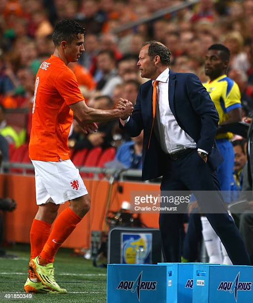 Robin van Persie of Holland is congratulated by Assistant manager Danny Blind as he is subbed off during the International Friendly match between The...