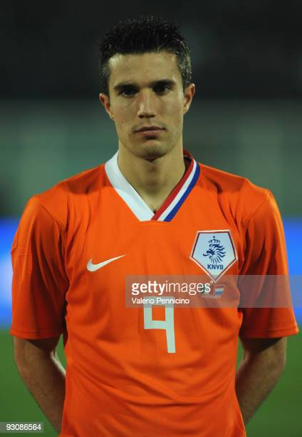 Robin van Persie of Holland lines up for the anthems prior to kickoff during the international friendly match between Italy and Holland at Adriatico...