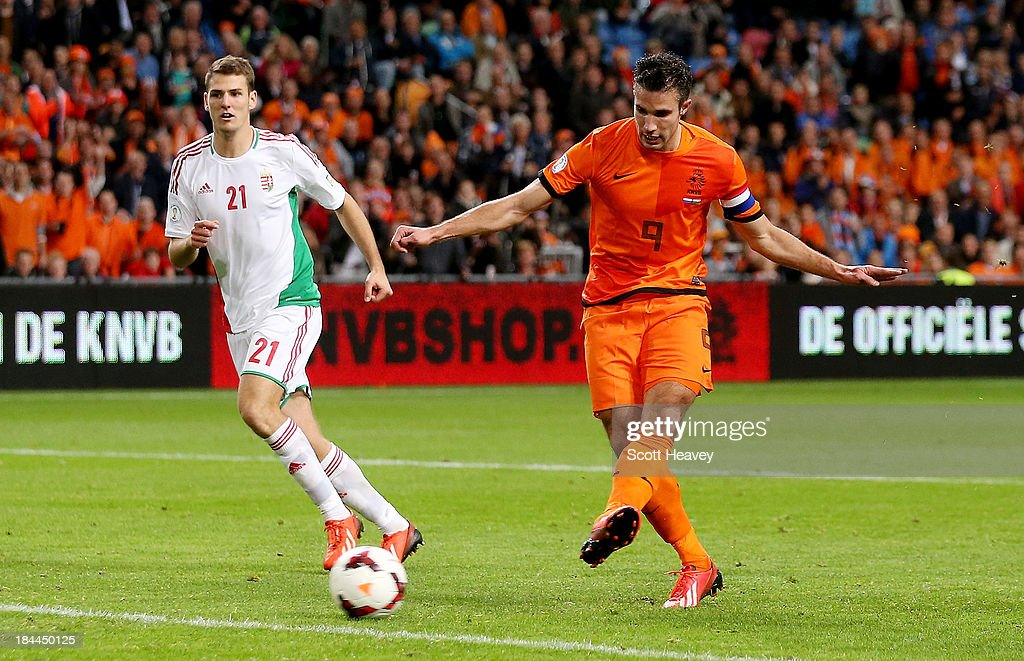 Robin van Persie of Holland scores their fifth goal during the FIFA 2014 World Cup Qualifing match between Holland and Hungary at Amsterdam Arena on October 11, 2013 in Amsterdam, Netherlands.